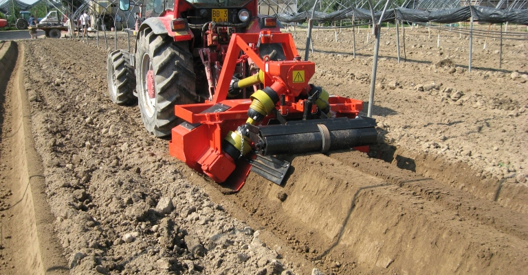 B10 bedformer on the field for strawberry cultivation